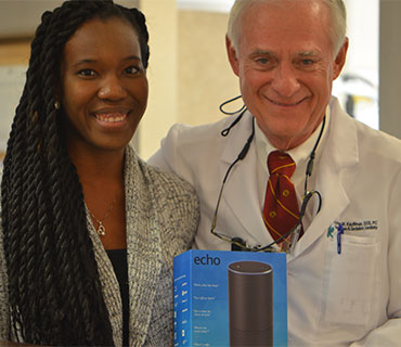 Dr. Kauffman with a smiling female patient